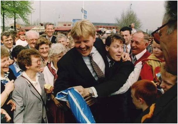 Queen's Day, 1994. Crown Prince Willem-Alexander and his brother Constantijn dancing amidst the local people of Emmeloord.