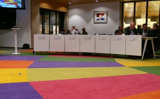 "In its anniversary year of 2012, the Noordoostpolder municipality is spicing up its image. Mayor Aucke van der Werff illustrated this new zest with a brightly coloured carpet in the renovated council hall . See also ""Gemeenteraad Noordoostpolder Eerste Webcast, 2011""."
